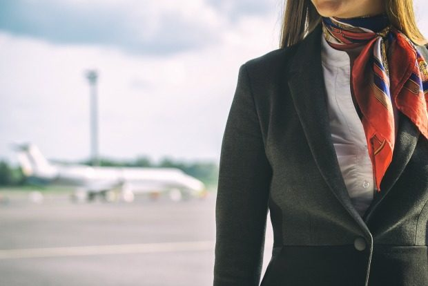 flight attendant on tarmac